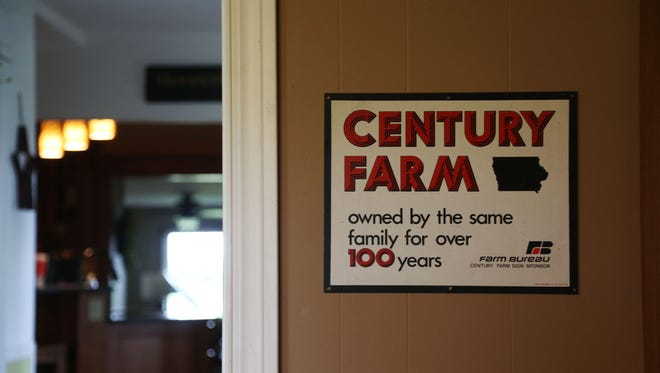 Gina Bennett's family farm has been owned by her family since 1852 and was honored as a century farm by the Iowa State Fair in 1976, the sign now hangs in Bennett's home office on Wednesday, Aug. 3, 2016, in rural Keota.
