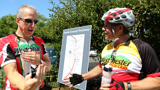 Joe Newbury, left, of Irvington Mark Garrahan of Hastings-on-Hudson, talk about the dangers of cycling on Route 9A.
