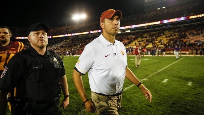 Iowa State coach Matt Campbell takes the field to shake hands with UNI Coach Mark Farley after UNI beat Iowa State 25-20 at Jack Trice Stadium Saturday, Sept. 3, 2016.