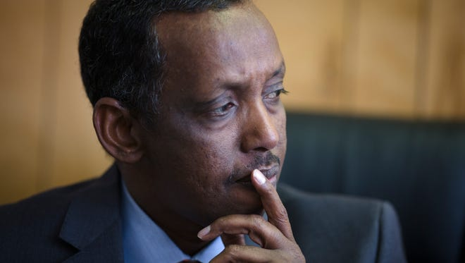 Hassan Omar, president of the Somali Community Association of Ohio, sits in his office Wednesday, Nov. 30, 2016, two days after Abdul Razak Ali Artan, a Somali immigrant, was shot and killed by an OSU police officer after Artan attacked pedestrians with a car and a butcher's knife.
