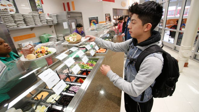 Christopher Panza, 16, selects some items from the salad bar at Peekskill High School.