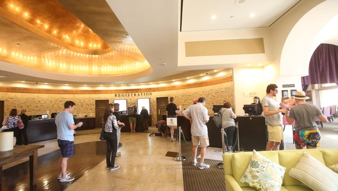 Guests in the lobby of the Westin Mission Hills Golf Resort & Spa in Rancho Mirage check in on Oct. 7, 2016, during the first weekend of Desert Trip. The mega music festival contributed to record growth in key tourism economy indicators such as average daily room rates.