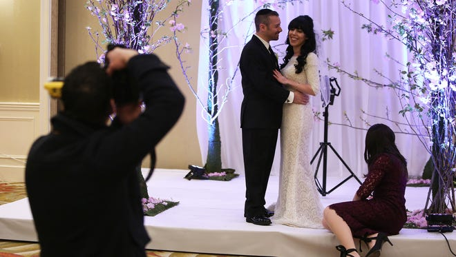 Giddy Straus, 35, and his bride, Elana Lev, 24, moved up their Tuesday wedding to Monday because of the expected blizzard. The couple pose for photos before the wedding at the Double Tree by Hilton Hotel in Tarrytown March 13, 2017.