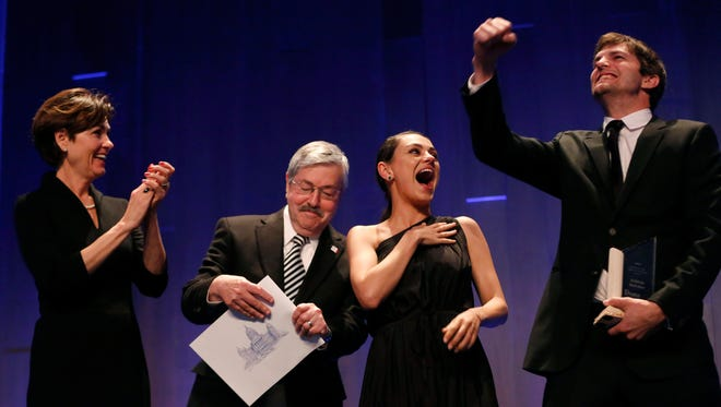 Actress Mila Kunis laughs as Gov. Terry Branstad and Lt. Gov. Kim Reynolds present her with a certificate making her an honorary Iowan Saturday, April 8, 2017, following Ashton Kutcher's award ceremony at An All-Star Evening at the Robert D. and Billie Ray Center in West Des Moines.