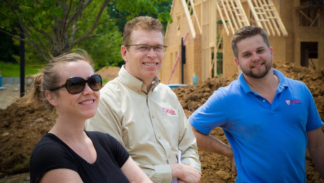 Alan Looney, center, president of Castle Homes, meets onsite with his project manager Michael Smith  and interior designer Joy Huber to discuss details of his fall Parade home, an English Country style home in Witherspoon neighborhood.