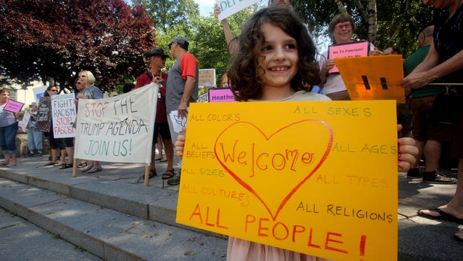 Eliana DiBonaventura, 6, of Hastings-on-Hudson was among the approximately 75 people from throughout Westchester that held a vigil in Hastings-on-Hudson Aug. 19, 2017 to protest the white nationalists who marched in Charlottesville, Virginia, and to also voice their feelings about President Donald Trump. The vigil was organized by three grassroots groups, Concerned Families of Westchester, the Greenburgh Human Rights Activism Committee, and Hasting RISE (racial inclusion and social equality).