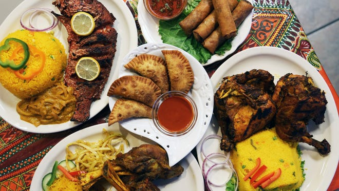 A spread of Senegalese dishes from Maty's African Cuisine in the Old Redford neighborhood of Detroit.