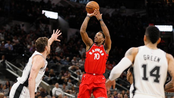Toronto Raptors shooting guard DeMar DeRozan (10) shoots the ball over San Antonio Spurs center Pau Gasol (16) during the second half at AT&T Center.