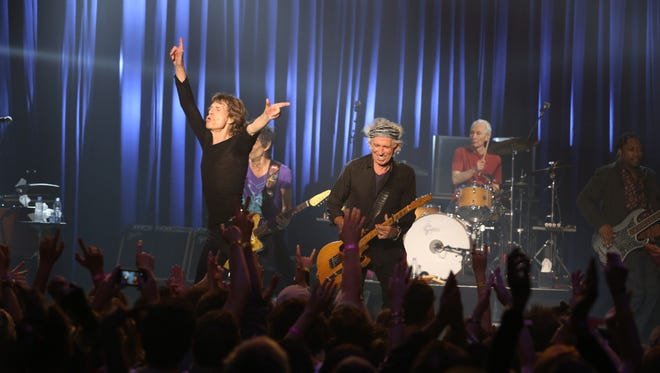 """Mick Jagger and the Rolling Stones perform at the Fonda Theatre in Los Angeles, Wednesday, May 20, 2015. The Rolling Stones ripped through the intimate Fonda Theatre Wednesday with enough energy to fuel their entire 15-city North American tour. The band announced Wednesday morning it would perform a """"club show"""" that night to kick off its Zip Code tour, which launches Sunday in San Diego. The surprise concert at the 1,300-person-capacity venue instantly sold out."""