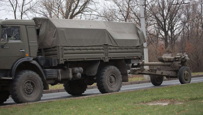 A truck tows a 122mm howitzer artillery piece on Nov. 11 on a main road east of Donetsk, Ukraine.