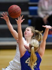 Albany's Amber Swarthout is fouled by Sartell's Meleah