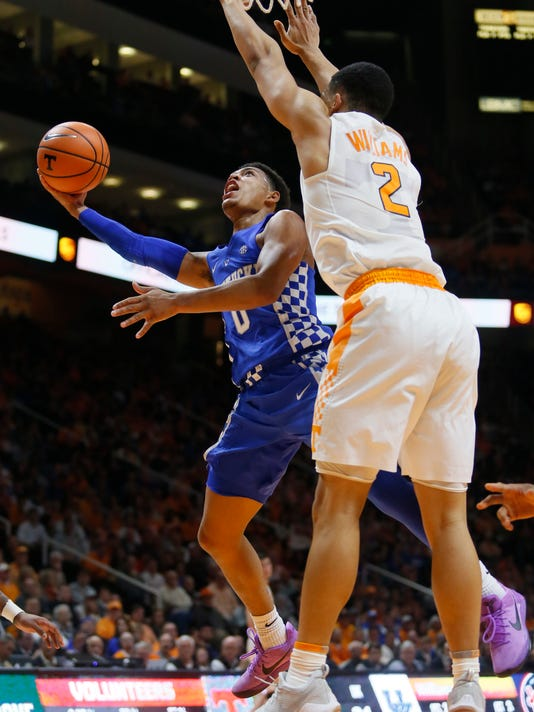 Kentucky guard Quade Green (0) goes up for a basket beside Tennessee forward Grant Williams (2) during the first half of an NCAA college basketball game Saturday, Jan. 6, 2018, in Knoxville, Tenn. (AP Photo/Crystal LoGiudice)