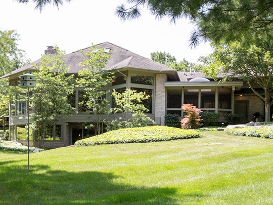 The lower level walks out to 1.7 acres of landscaped gardens in Ann Arbor.