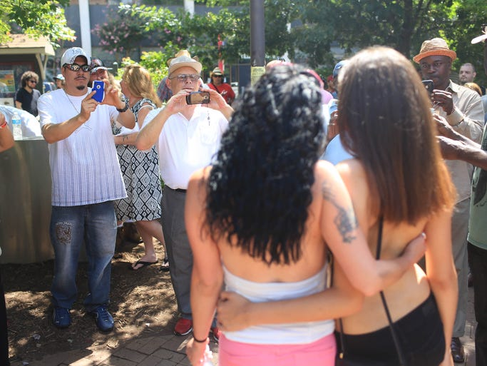 Crowds gathered in Pritchard Park on Sunday afternoon to observe the yearly Topless Rally - held in support of a woman's right to go topless in public in North Carolina. -Colby Rabon (colbyrabon@gmail.com) August 24, 2014.