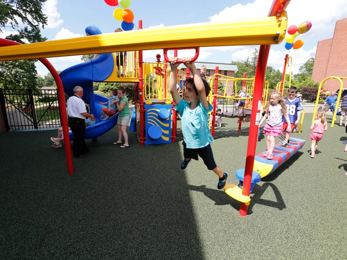Children play in the Herbert and Edythe Kurz Accessible Playground at the Helen Hayes Hospital in West Haverstraw during the playground grand opening on June 22, 2014.