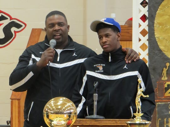 South Side basketball coach DaMonn Fuller, left, addresses the crowd with Jaylen Barford, right, at a celebration of the Class AA state championship in 2014.