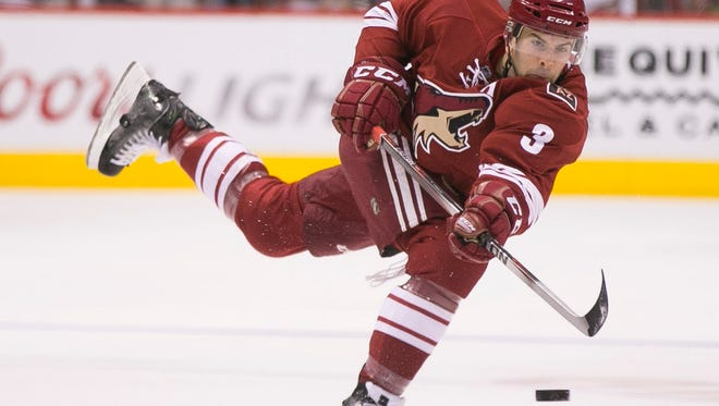 Coyotes' Keith Yandle shoots against the Panthers in the first period at Gila River Arena in Glendale on Saturday, Oct. 25, 2014.
