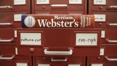 """Merriam-Webster dictionary sits atop their citation files for the 2014 word of the year, """"culture."""""""