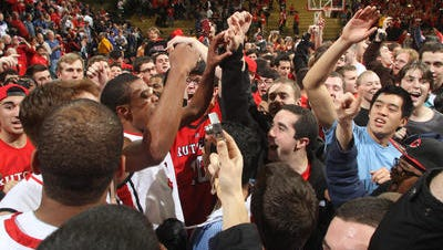 Rutgers players and fans celebrate after an upset of No. 4 Wisconsin Jan. 11 -- the Scarlet Knights'  last win.