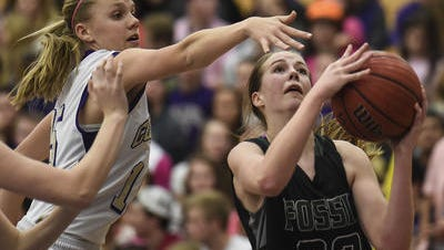 Britt Mishak, shown in a file photo, was one of three players to score in double figures to help lift Fossil Ridge past Monarch on Friday.