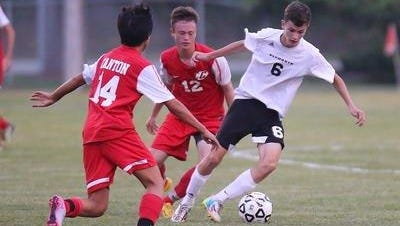 During this 2015 contest, Plymouth's Adam Saunders (No. 6) tries to get a step on Canton's  Joey Chung (No. 14) and Matt Rockafellow (No. 12). All are being counted on by their respective teams as key players for the upcoming season.