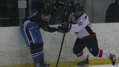 One of Livonia Franklin's key returning players is forward Nic Anderson (right), shown from a 2015-16 contest.