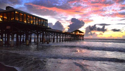 A sunrise at the Cocoa Beach Pier in September.