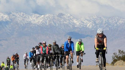 This Desert Sun file photo shows riders participating in the Tour de Palm Springs. The annual bike ride happens Saturday and bicyclists will be sharing roads with vehicle traffic.