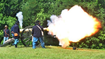 Vicksburg National Military Park's cannon detachment fires a bronze cannon Saturday to commemorate the 151st anniversary of the surrender of Vicksburg at Battery DeGolyer.