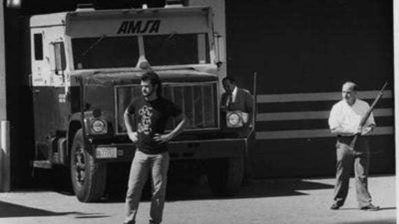 AMSA employees guard the truck robbed in 1990.