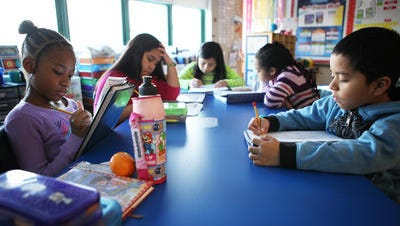 Third-grade students work on a math problem at Alice E. Grady Elementary School in Elmsford.