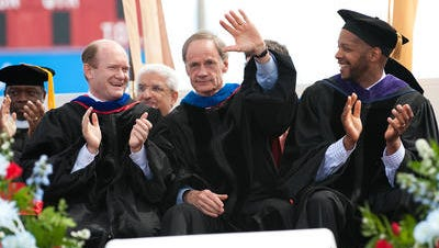 U.S. Sens. Chris Coons and Tom Carper, and Warren Brown, at the Delaware State University commencement, May 2012.