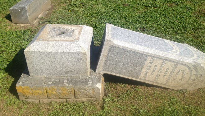 The headstone that is costing convicted vandals $12,000 in damages.