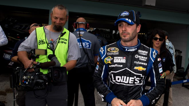 An ESPN cameraman follows six-time Sprint Cup champion Jimmie Johnson, who has delivered dominance if not drama, during the season finale at Homestead-Miami Speedway on Nov 15
