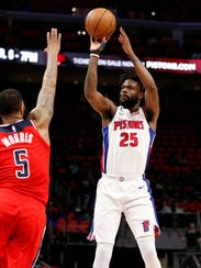 Pistons guard Reggie Bullock (25) takes a shot over