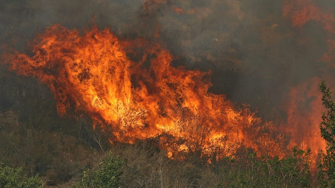 The Silver Fire engulfs vegetation in the Twin Pines Ranch area on Aug. 8, 2013.