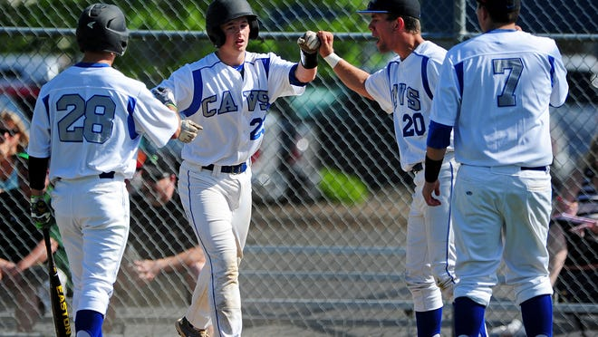 Blanchet Catholic's Nate Cantonwine (23) is greeted by teammates after hitting a home run against Rainier during the first round of the OSAA Class 3A state playoffs, on Wednesday in Salem. Rainier won the game 6-5.