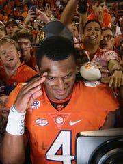 Clemson quarterback Deshaun Watson (4) celebrates with