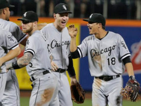 From left, Chicago White Sox second baseman Brett Lawrie, third baseman Todd Frazier and shortstop Tyler Saladino (18) celebrate after the White Sox beat the New York Mets 6-4 in a baseball game, Tuesday, May 31, 2016, in New York. (AP Photo/Julie Jacobson)