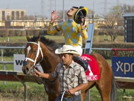 Miguel Mena after Dynamic Impact's number was put up as the winner of the Illinois Derby. Four Footed Fotos