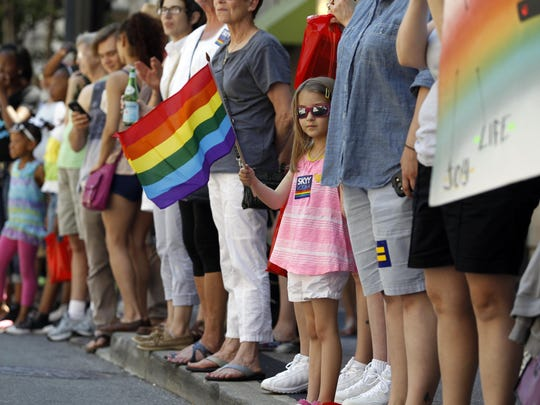Ari Schaffer, 6, of Mount Washington waves a rainbow