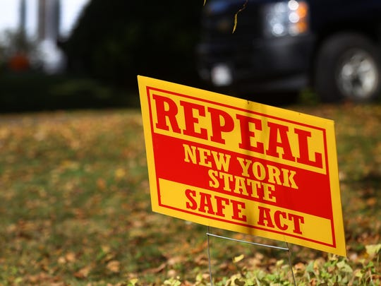 A file photo of a sign urging the repeal of the SAFE Act on a lawn in Perinton.