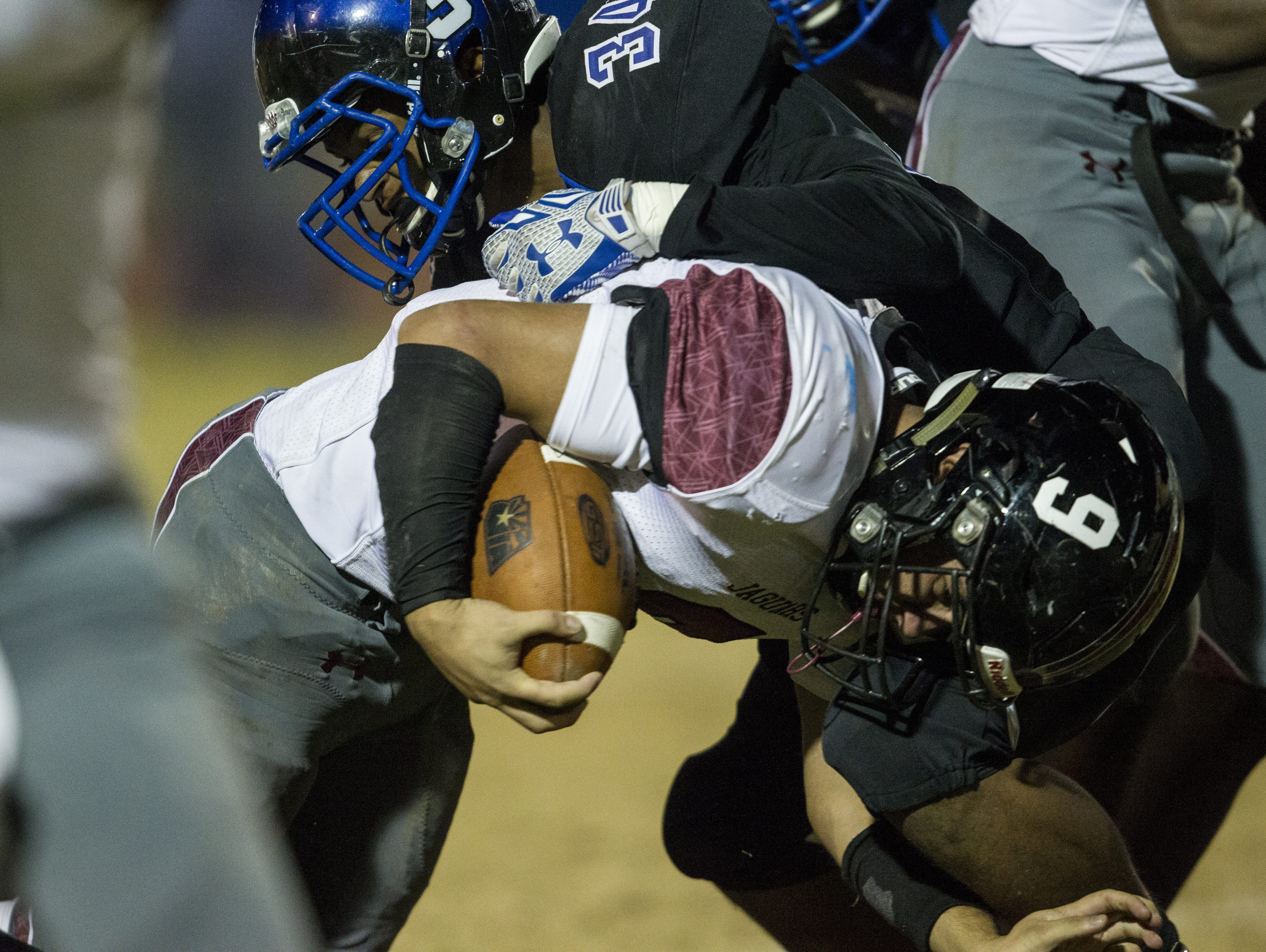 Desert Ridge's Stephan Gomez rushes against Chandler in the second quarter on Friday, Nov. 20, 2015 during the Division I state semifinals at Hamilton High School in Chandler, Ariz.