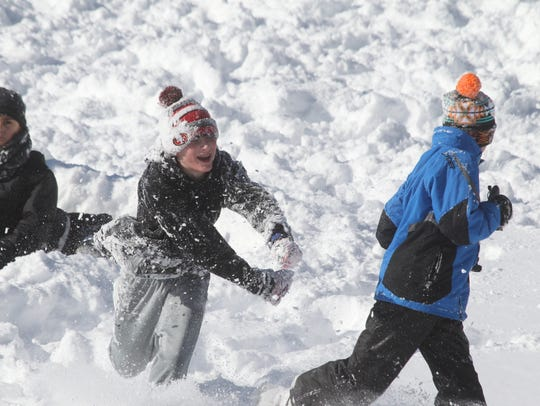 Sledding, tubing and snowboarding at Veterans Memorial