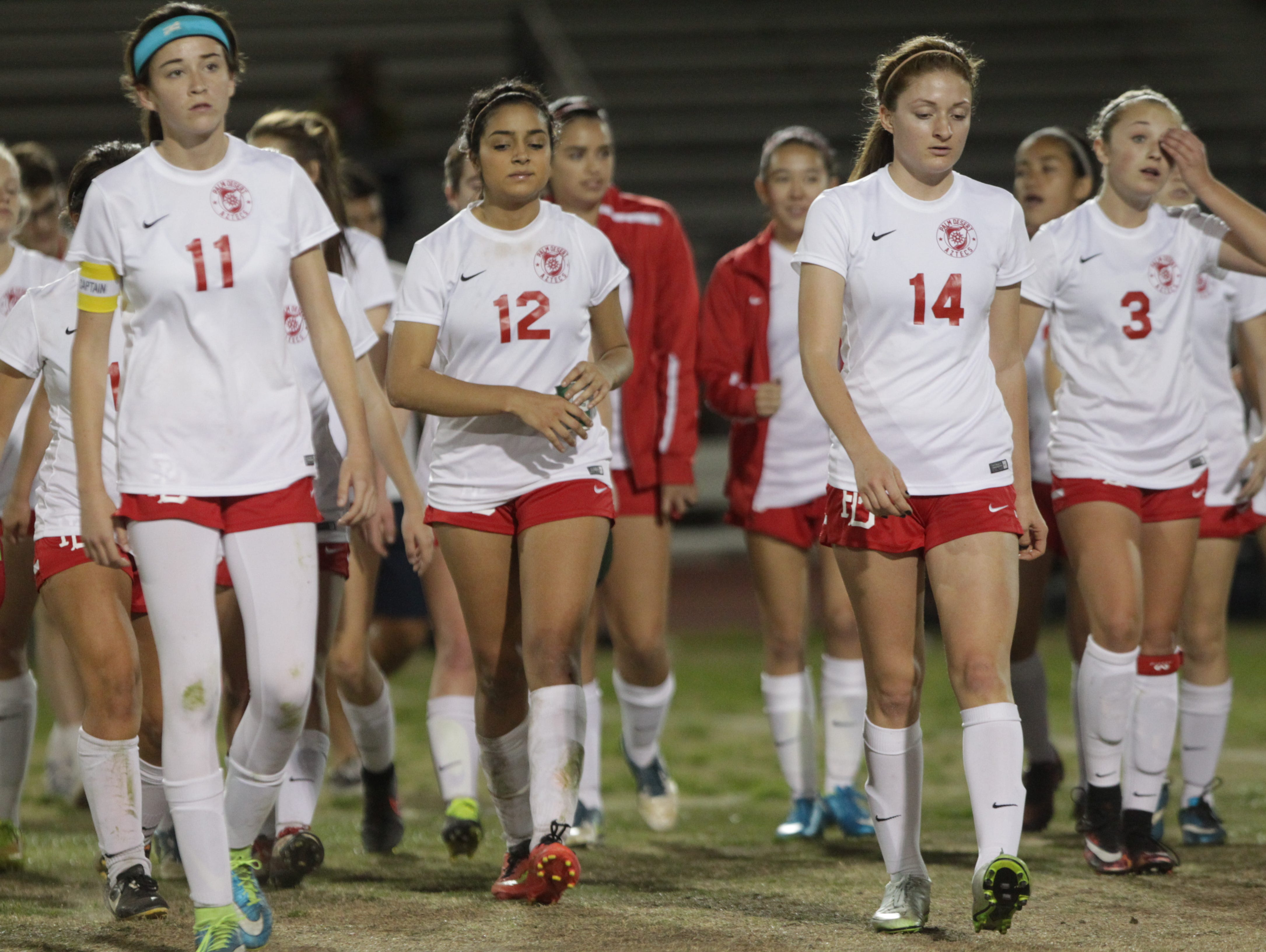 Dejected Palm Desert High School players walk back after losing their CIF Game 1-0 to California High School of Whittier at Palm Desert.