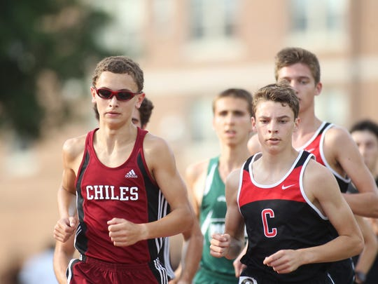 Chiles sophomore Matthew Newland tries to keep pace with a pair of Creekside runners during the 3200-meter run in Thursday's Region 3-3A meet. Newland won, his first victory ever.