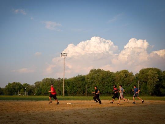Children run bases in Pyne Poynt Park in Camden in