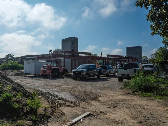 Work continues on the site of the Red Cedar Flats student housing project at Northwind Drive and Grand River Avenue in Meridian Township on Monday, Aug. 29, 2016.