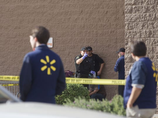 Glendale police officers talk to Walmart employees and eyewitnesses after two people were shot inside a Glendale Walmart located near 95th Avenue and Camelback Road on the morning of Dec. 7, 2016. Neither of the victims suffered life-threatening injuries, police said.
