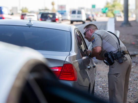 Arizona Department of Public Safety Trooper Robert Olshaskie makes a traffic stop on Interstate 17 on Friday, July 1, 2016, in Phoenix.